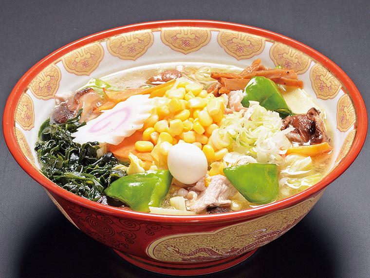 「大學らーめん」(880円)。シイタケやピーマンなど11種の野菜がたっぷりと入った人気の一品。バターの風味が効いた和風ミックスの味がクセになる