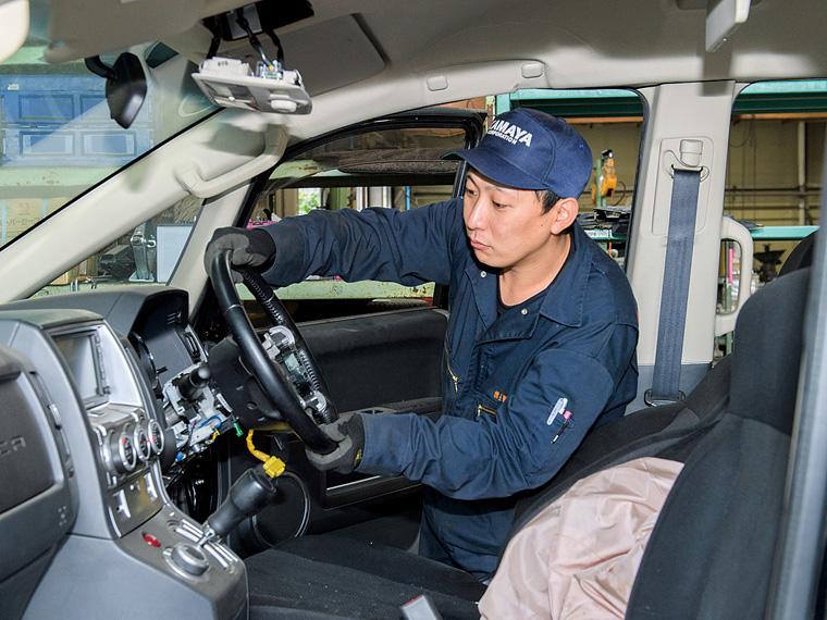 「車の解体部品数1日300以上が目標。手際よくこなしたい」と佐藤優樹さん