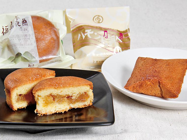 リンゴのシロップ漬けをサンドした「福島夜曲(せれなあで)」(写真左・173円)、ラムレーズン餡を包んだ「ハモンドの調べ」(写真右・140円)